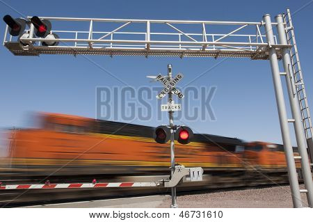 Train speeding by railroad crossing
