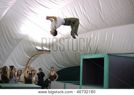 MOSCOW - NOV 17: A man does a somersault on the 5th parkour contest to move at the University of Physical Education, Max Attack: Death Circle, on Nov 17, 2012 in Moscow, Russia