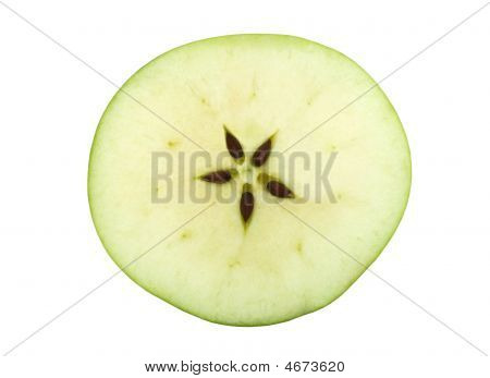 Half Of A Green Apple With Five Seeds