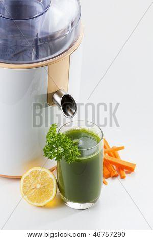 Healthy green vegetable juice with juice extractor