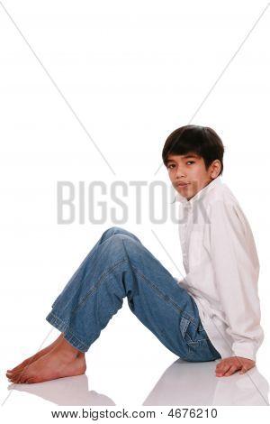 Twelve Year Old Boy Sitting On Floor