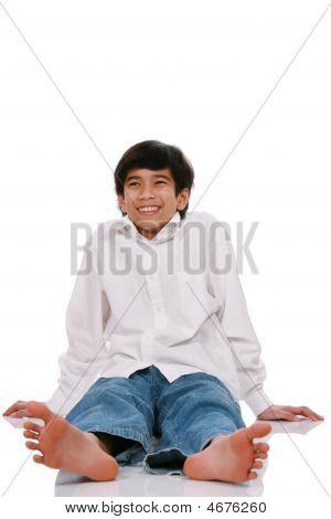 Teen Boy Sitting On Floor