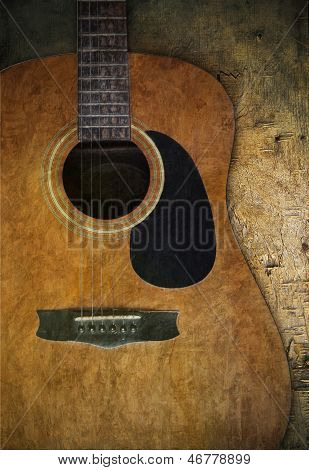 Old Guitar On Wood Textured