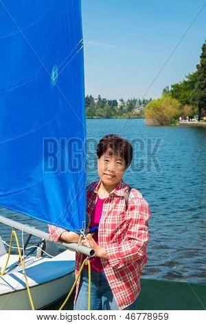 Asian Woman and Sailboat