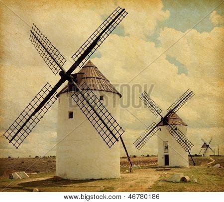 Medieval Windmills. Castilla La Mancha, Spain. Paper texture. poster