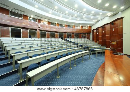 MOSCOW - AUG 18: Desks and seats in empty university auditorium in MGIMO, on Aug 18, 2012 in Moscow, Russia. Among MGIMO graduates more than five thousand foreign citizens from more than 60 countries.
