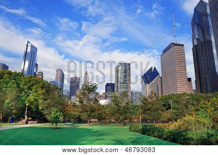 Chicago city downtown urban skyline with skyscrapers and cloudy blue sky over park.