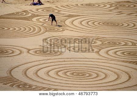Man creating sand art