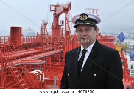 Captain looking ahead on the navigation bridge of ocean ship poster