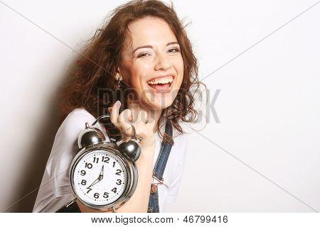 Young fun woman with alarmclock