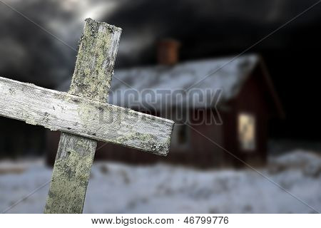 Old Shack And Wooden Cross