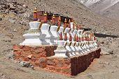 Buddhistic stupas (chorten) in Tibet  poster