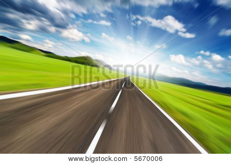 Empty road with motion blur and blue sky poster