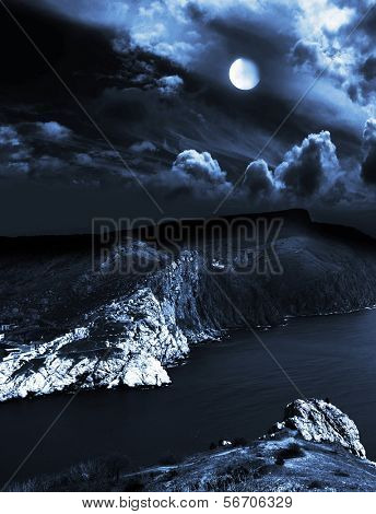 moonlit night and clouds on night sky in the sea