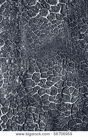 The surface of the solidified Black crack tar. The original background of black.