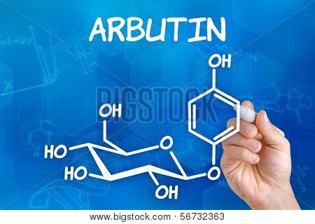 Hand with pen drawing the chemical formula of arbutin