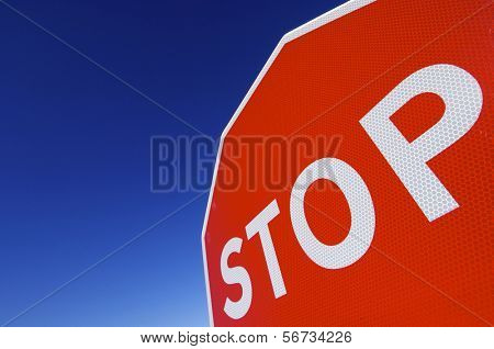 stop word written on a traffic signal