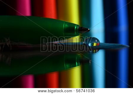 colourful pen with background and shadow on the table poster