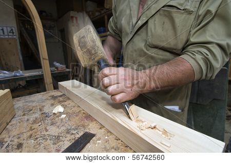 forefront of the hands of a carpenter working
