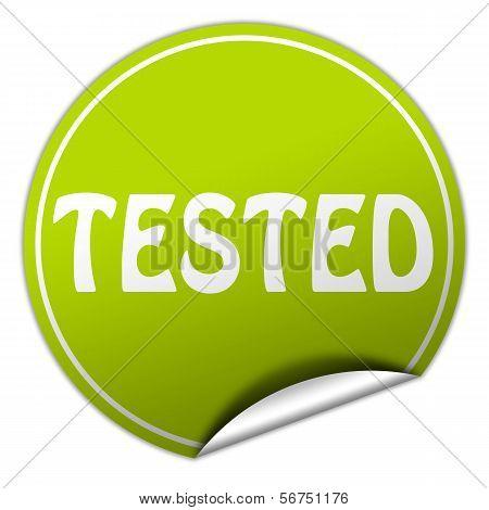 Tested Round Green Sticker On White Background