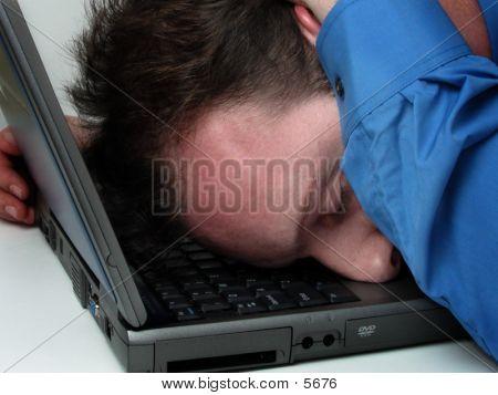 Man Fallen Asleep On His Laptop