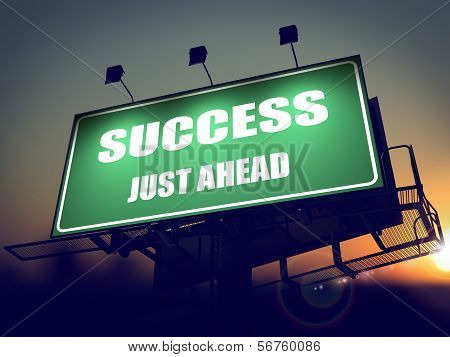 Success Just Ahead on Green Billboard.