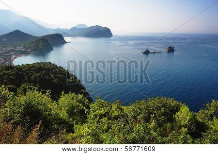 coast between Budva and Bar, Montenegro. In the bay are two islets called Katic and Sveta Nedjelja