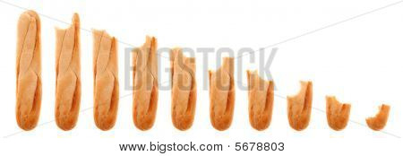 Series of whole and bitten baguette progressively being eaten away