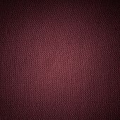 Closeup macro of red brown fabric textile material as texture pattern background or backdrop. Square format. poster