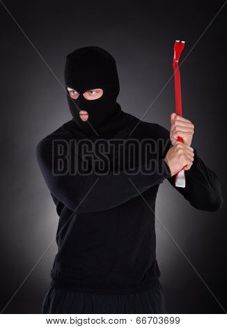 Masked Thug Or Criminal With A Crowbar