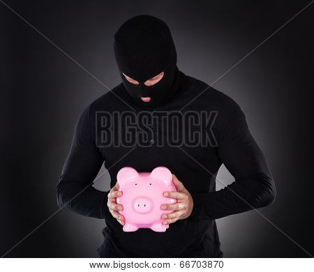 Burglar Stealing A Pink Piggy Bank