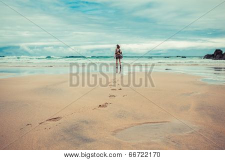 Footprints Left By Young Woman On Beach