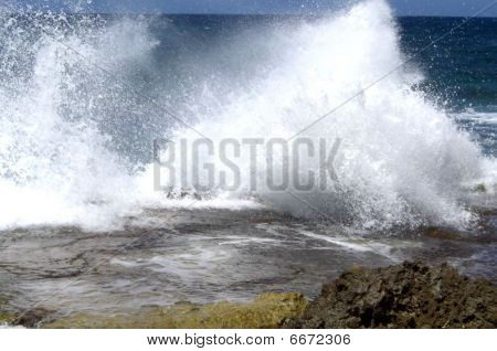 Breaking waves over volcanic rocks
