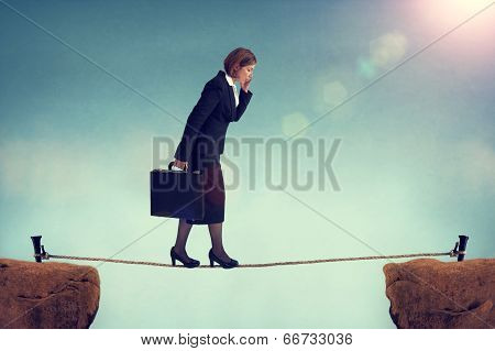 Confident Businesswoman Walking A Tightrope