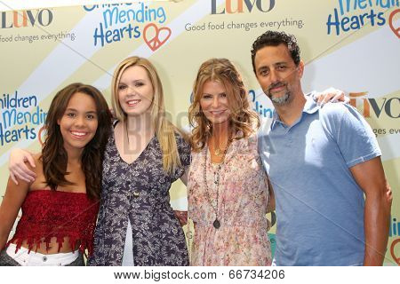 LOS ANGELES - JUN 14:  Lysa Heslov, Grant Heslov, Daughters at the Children Mending Hearts 6th Annual Fundraiser at Private Estate on June 14, 2014 in Beverly Hills, CA
