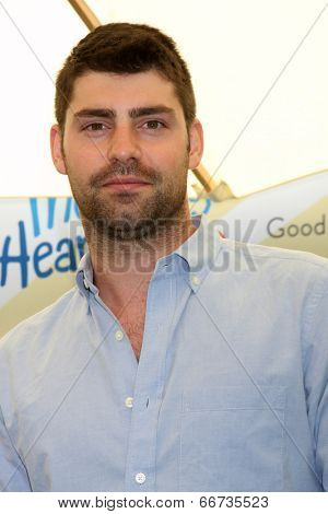 LOS ANGELES - JUN 14:  Travis Milne at the Children Mending Hearts 6th Annual Fundraiser at Private Estate on June 14, 2014 in Beverly Hills, CA