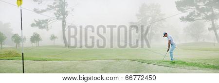 Golf chip panorama misty morning on fairway near green
