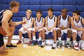 Male High School Basketball Team Having Team Talk With Coach poster