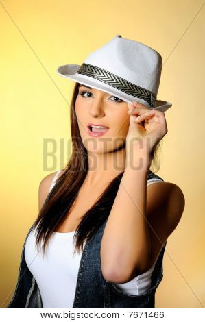 Young Sexy Model In Jeans And White Hat.