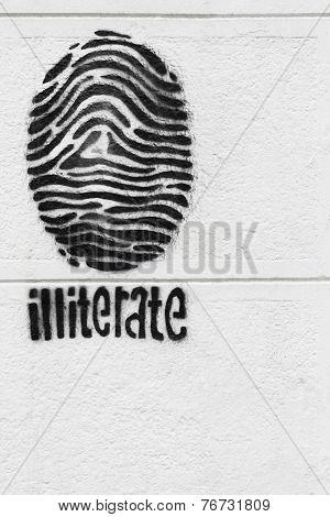 Fingerprint On A White Wall- Symbol Of Illiteracy