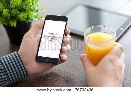 Man Holding Iphone 6 With Pinterest On The Screen