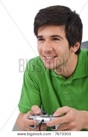 Young Happy Man Playing Video Game With Control Pad