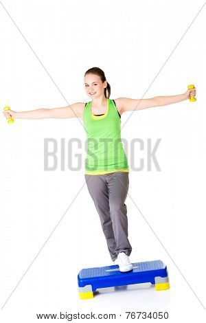 Beautiful sporty woman doing aerobic excersises.