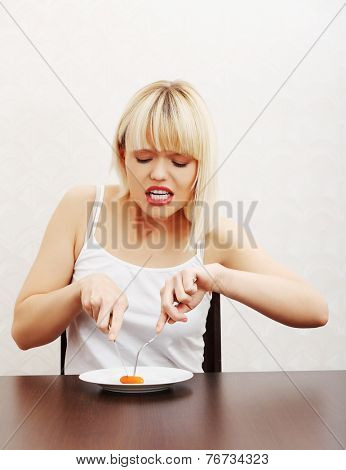 Diet concept. Young woman eating carot.