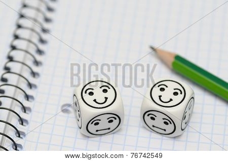 Open Exercise Book With Pencil And Mood Dices Showing Happy Face