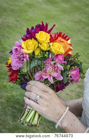 Bride Displaying Flowers And Wedding Ring