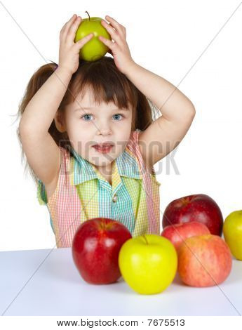 Little Girl Plays With Fruit - Apples