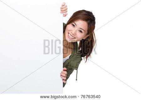 Woman peeking on big white board