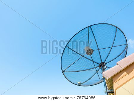 Image Of Satellite On Roof With Blue Sky