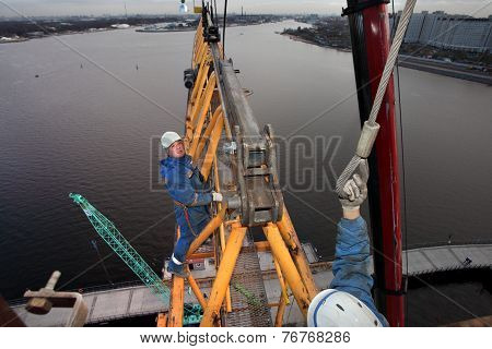 Workers Installers Fixed Working Construction Boom Hoisting Tower Crane.